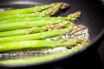 asparagus cooking in pan