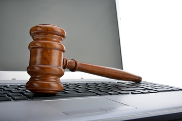 Close-up of a gavel on computer