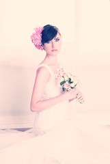 beautiful young girl in a wedding dress close-up