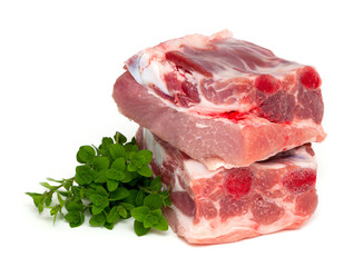 piece of pork ribs and marjoram herb