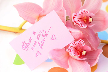 bouquet of orchids and a message for the woman he loved