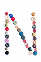 Letter alphabet formed of buttons