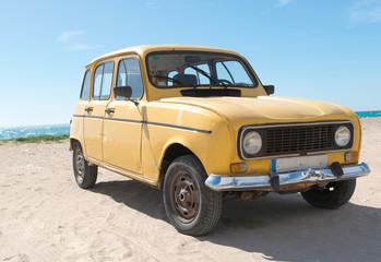 Yellow retro car by the sea