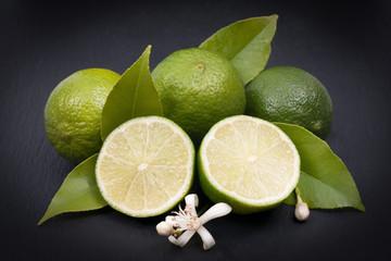 Fresh limes on a slate