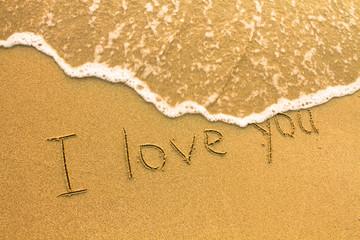 I love you - inscription on the beach sand