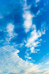 Blue sky with white light clouds