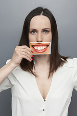 woman holding picture with big happy smile