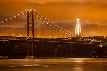 25 de Abril bridge over Tagus river and big Christ in Lisbon