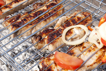 Appetizing roasted meat barbecue with fresh vegetables