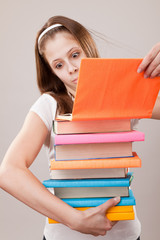 Teenager girl with books