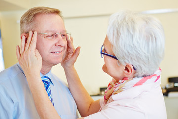 Man testing rimless glasses at optician