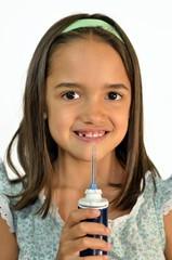 Little Hispanic Girl with Water Floss