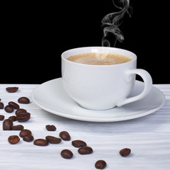 Hot coffee with smoke and coffee beans on wooden table