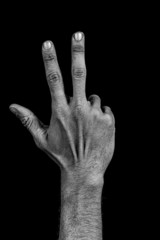 Hand on black back - three