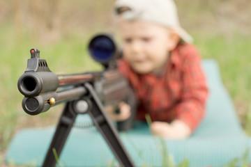 Little boy playing rifle