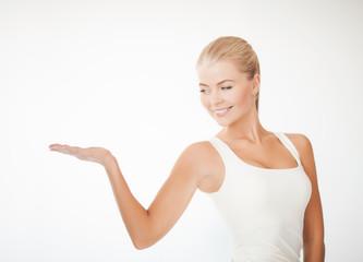 woman in sportswear with empty hand