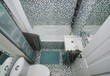 Small, modern bathroom interior. Mosaic tiles.