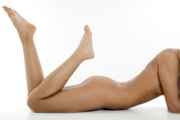 Naked young woman on white