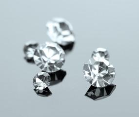 Beautiful shining crystals (diamonds), on grey background