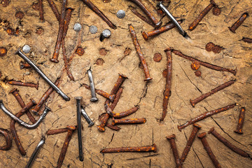 Old rusted and new nails in a trunk