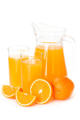 Fototapete - Orange juice in a glass jug
