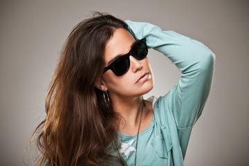 young woman portrait with fashion sunglasses