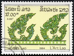 stamp printed in Laos shows Stylized leaves