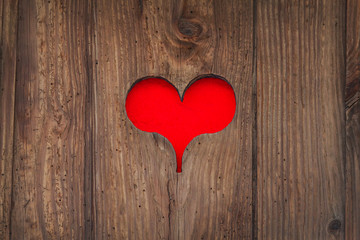 Cut out old wooden red heart shape