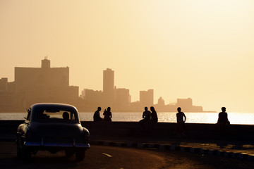 Aluminium Prints Old cars People and skyline of La Habana, Cuba, at sunset