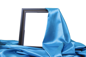 close up of a wooden frame covered with silk
