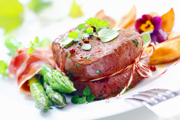 Thick juicy steak with fresh green asparagus