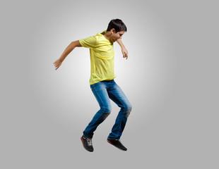 Young man dancing and jumping