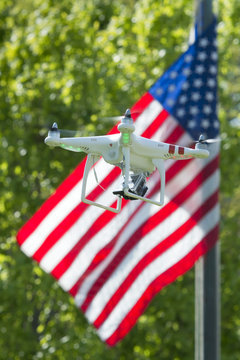A security drone on star and stripes USA flag