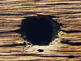 Wooden background with hole