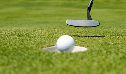 Putter and ball .