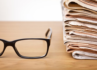 Glasses and newspapers