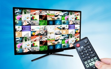 TV with multiple images gallery on blue background. Hand hold re