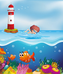 Keuken foto achterwand Onderzeeer A boy swimming with fishes and corals at the beach