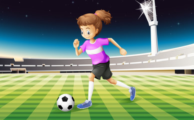 A girl at the field playing football