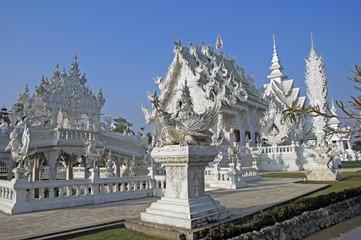 Modern Buddhist sculpture,..White temple in Thailand.