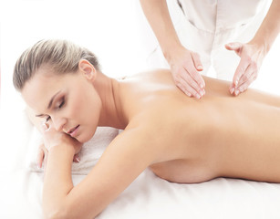 Young attractive woman getting spa treatment