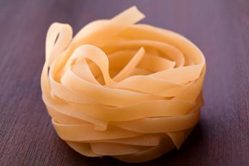 raw fresh tagliatelle pasta nest