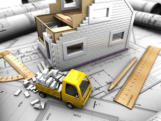 yellow truck and model of house