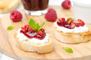 Toasted baguette with cream cheese, raspberry jam, raspberry