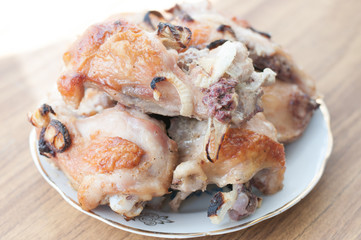 Grilled chicken legs on plate