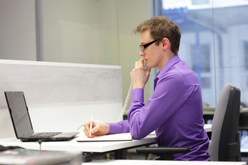 correct sitting position - man working in the office