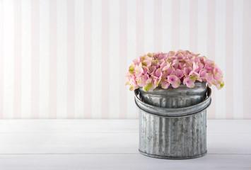 Hydrangea flowers in a metal bucket