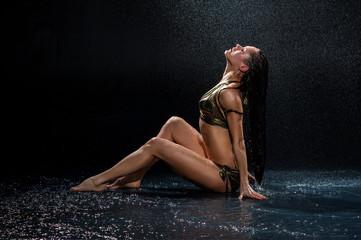 Woman under rain. Studio photo