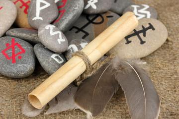 Fortune telling  with symbols on stones on burlap background