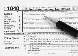 Form 1040 Tax Document with Pen